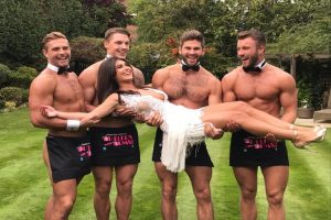 Four topless butlers holding a customer at private event in Ireland and Northern Ireland